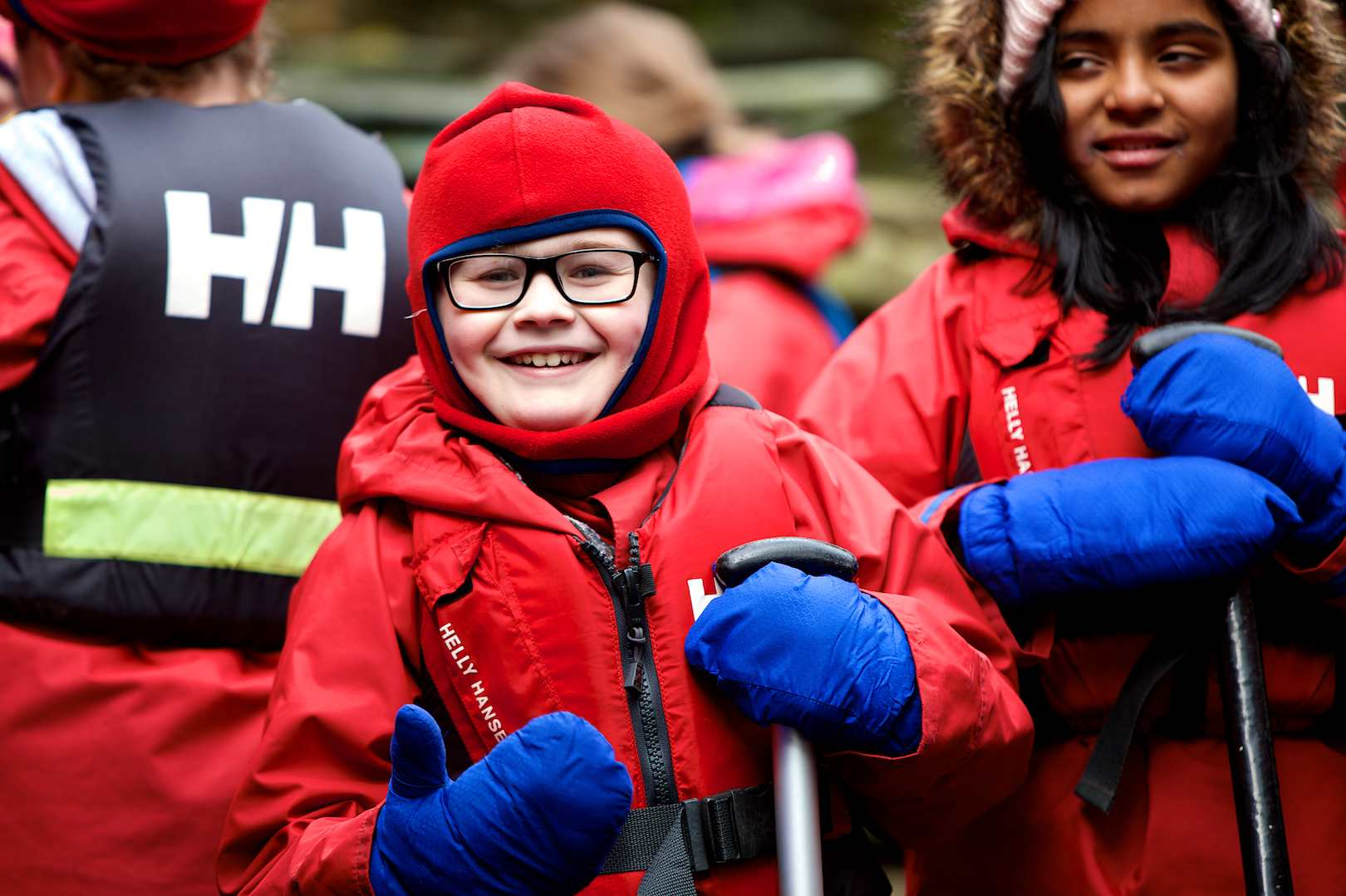 Happy pupils ready for canoeing on a cold day wearing balaclavas