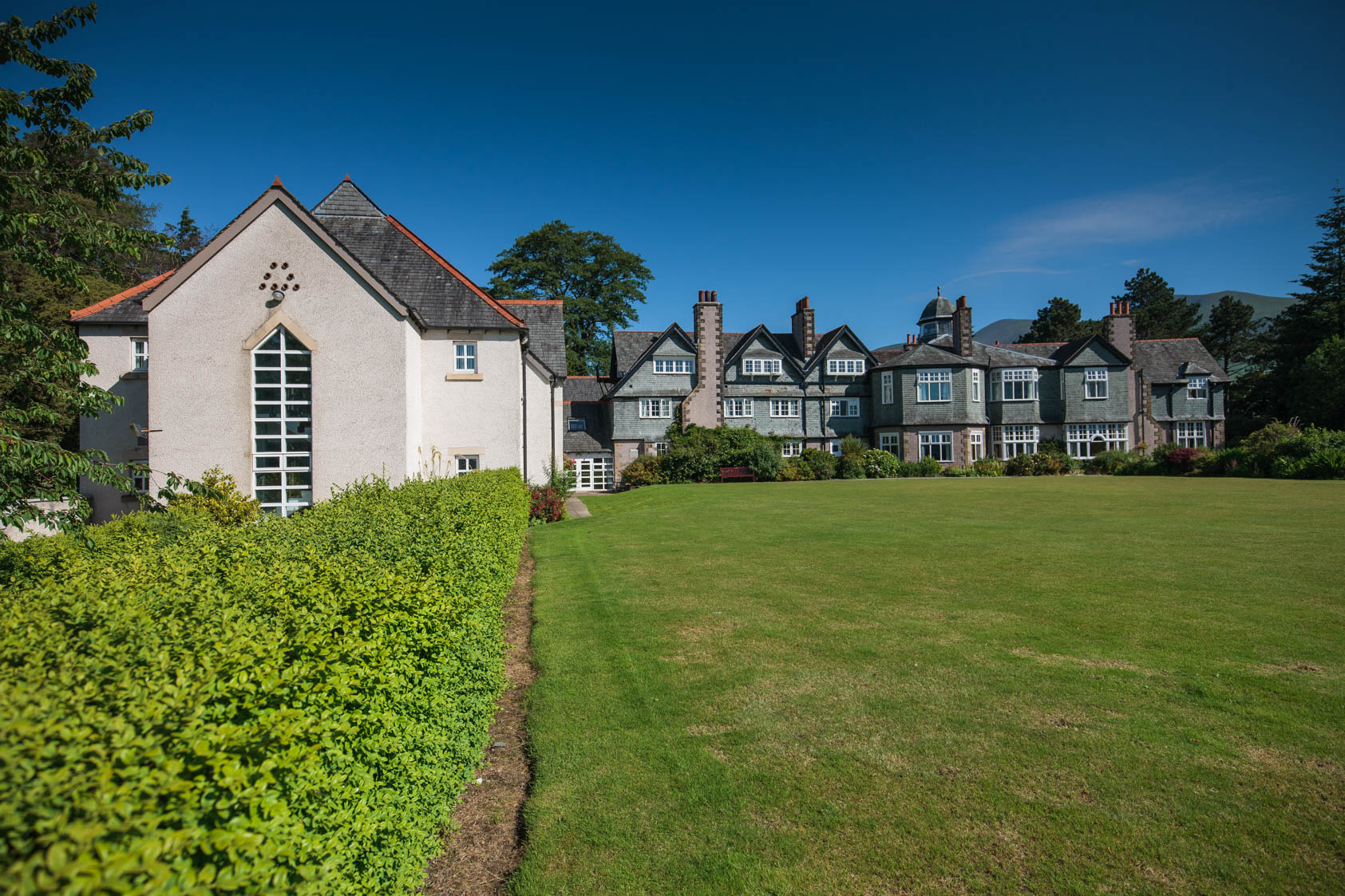 A sunny view of Derwent Hill and lawns