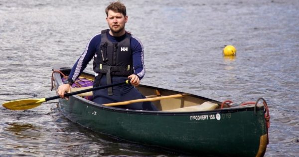An apprentice solo canoeing on Derwent Water