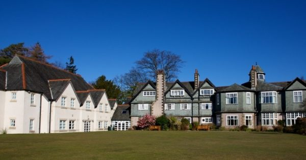 Derwent Hill's historic House and beautiful lawn on a sunny day
