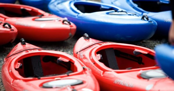 Red and Blue Kayaks ready for an outdoor adventure