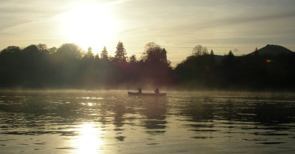 Canoeing on Derwent Water during a misty sunset