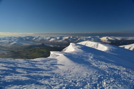Panoramic view of Cumbria's snow capped peaks from Blencathra