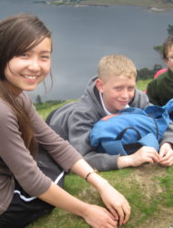 Primary School pupils happy relaxing on the side of Catbells