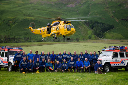 Cockermouth Mountain Rescue team photo with RAF Seaking hovering above