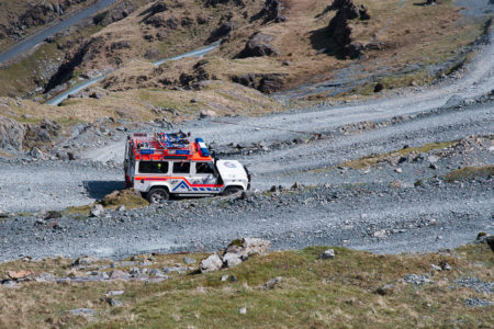 A Cockermouth Mountain Rescue Team Landrover driving down a very steep Honister Slate mine track