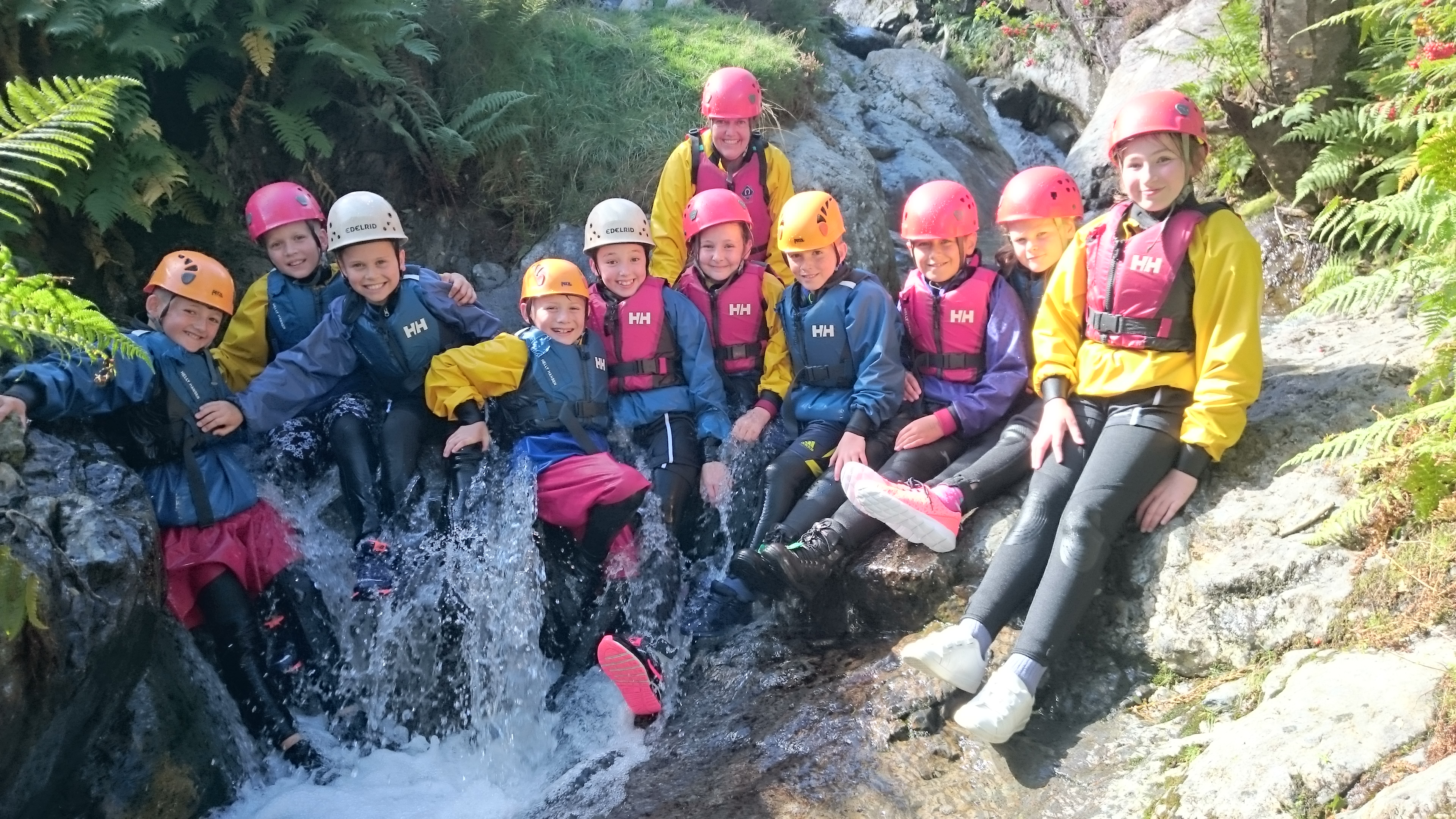 Fully equiped primary pupils posing in the gorge