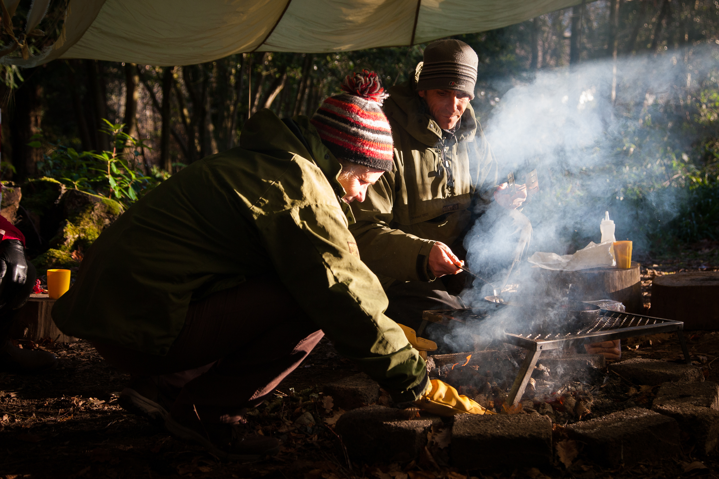 Sue Middleton Bushcraft cooking under a parachute in the woods