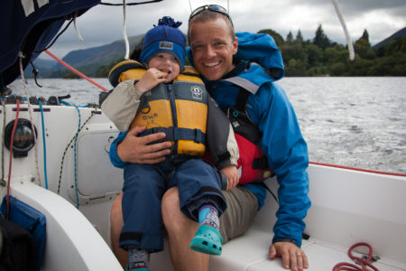 Nick Lumb with his young son on a sailing boat on Derwent Water