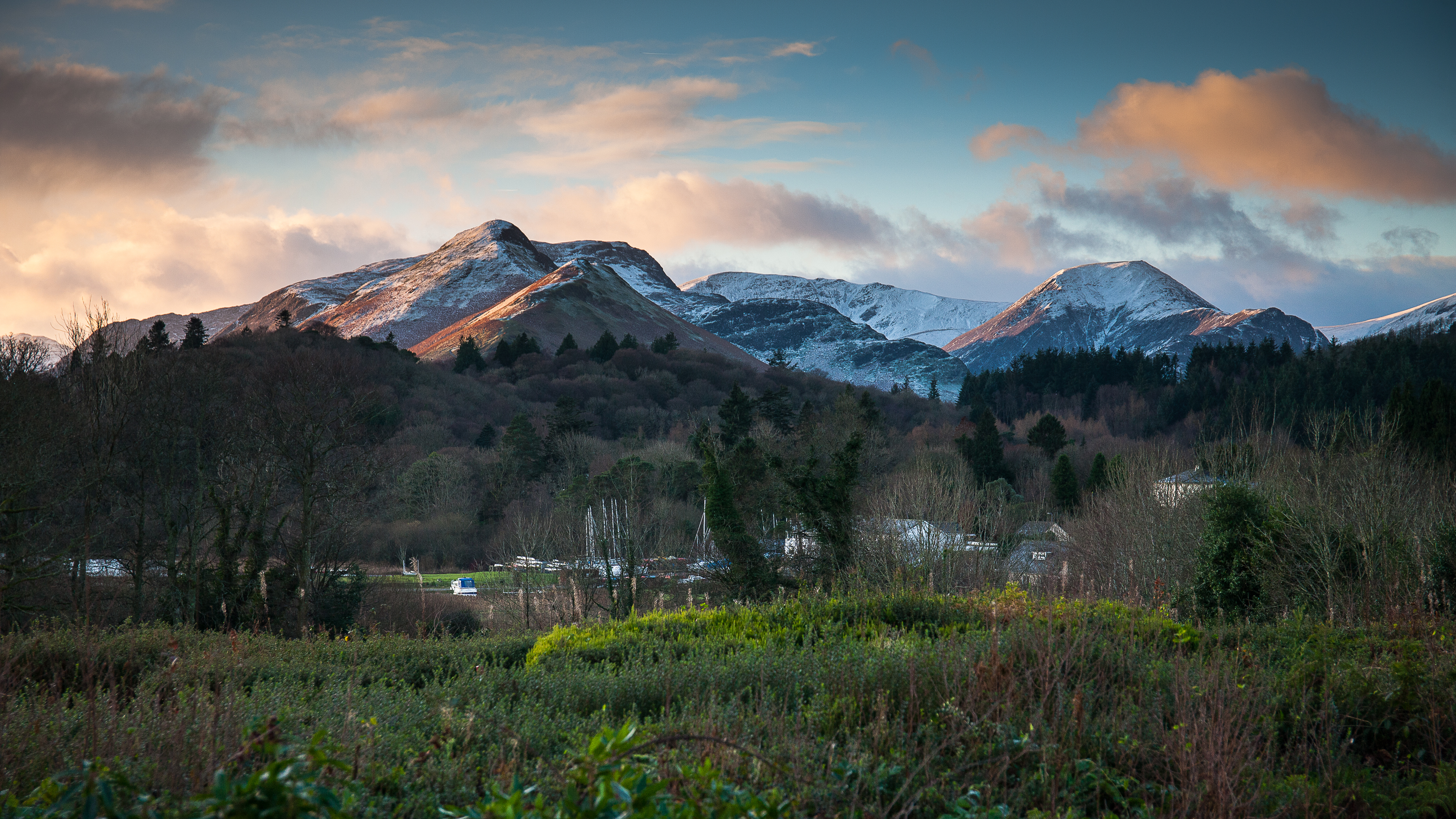 Beautiful view of snow capped Catbells from Derwent Hill's gardens
