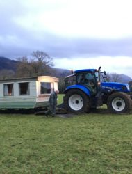 Old caravan being towed by a tractor in Derwent Hill's front field