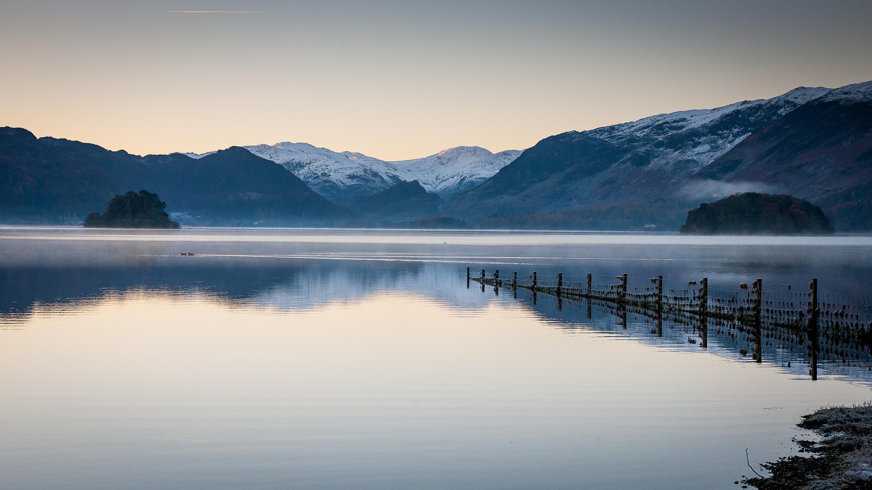 A calm, misty, winter sunset on Derwent Water